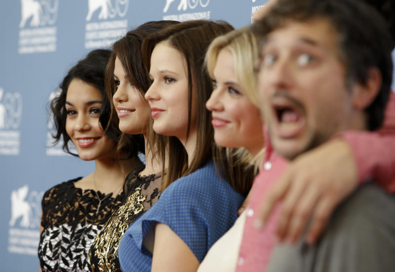 From left, actors Vanessa Hudgens, Selena Gomez, Rachel Korine, Ashley Benson and director Harmony Korine pose at the photo call for the film 'Spring Breakers' at the 69th edition of the Venice Film Festival in Venice, Italy, Wednesday, Sept. 5, 2012. (AP Photo/Andrew Medichini)