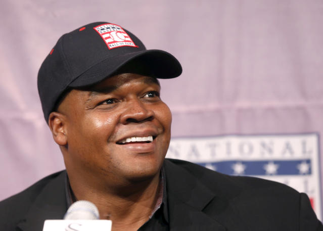 Chicago White Sox slugger Frank Thomas smiles as he listens to a question during a news conference about his selection into the MLB Baseball Hall Of Fame Wednesday, Jan. 8, 2014, at U.S. Cellular Field in Chicago. Thomas joins Greg Maddux and Tom Glavine as first ballot inductees Wednesday, and will be inducted in Cooperstown on July 27 along with managers Bobby Cox, Joe Torre and Tony La Russa, elected last month by the expansion-era committee. (AP Photo/Charles Rex Arbogast)