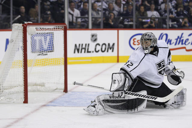 A Winnipeg Jets shot gets past Los Angeles Kings goaltender Jonathan Quick and hits the top-left corner during the second period of an NHL hockey game in Winnipeg, Manitoba, on Friday, Oct. 4, 2013. (AP Photo/The Canadian Press, John Woods)