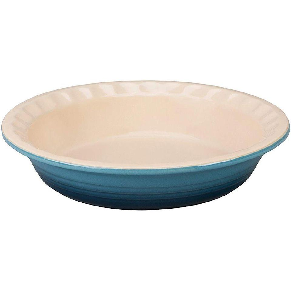 """<p><strong>Le Creuset</strong></p><p>amazon.com</p><p><strong>$41.38</strong></p><p><a href=""""https://www.amazon.com/dp/B00B4UPUIC?tag=syn-yahoo-20&ascsubtag=%5Bartid%7C2140.g.19983997%5Bsrc%7Cyahoo-us"""" rel=""""nofollow noopener"""" target=""""_blank"""" data-ylk=""""slk:Shop Now"""" class=""""link rapid-noclick-resp"""">Shop Now</a></p><p>This might be the prettiest pie dish ever. It makes your desserts look instantly professional. Any foodie will be pleased to add some fancy Le Creuset cookware to their kitchen collection.</p>"""