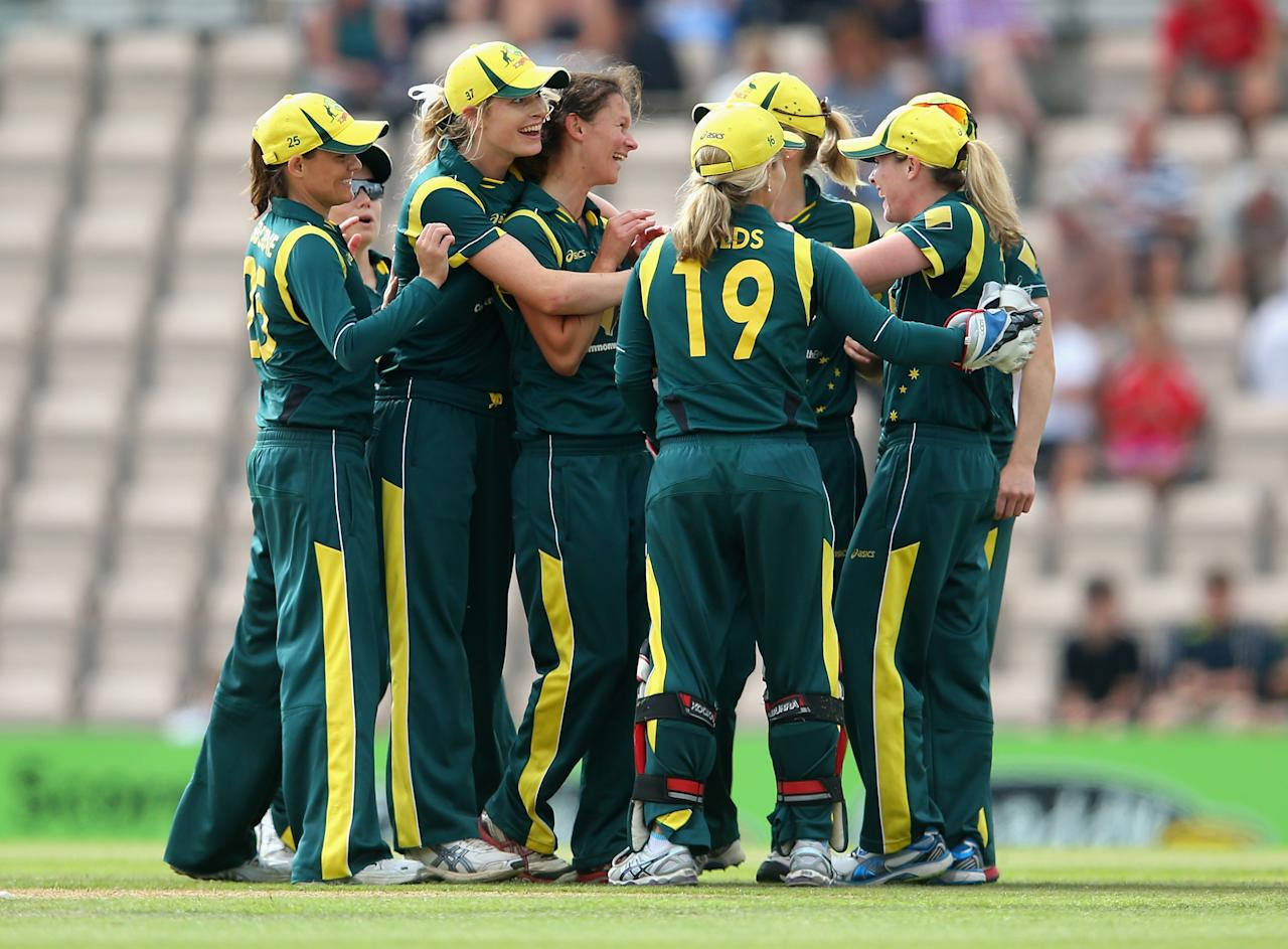 SOUTHAMPTON, ENGLAND - AUGUST 29:  Julie Hunter of Australia is congratulated by team mates after bowling out Heather Knight of England during the 2nd NatWest T20 match between England Women and Australia Women at Ageas Bowl on August 29, 2013 in Southampton, England.  (Photo by Julian Finney/Getty Images)