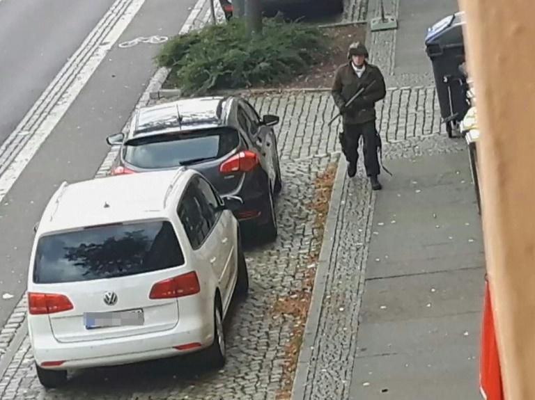 A video screenshot shows an armed man in the streets of Halle on Wednesday