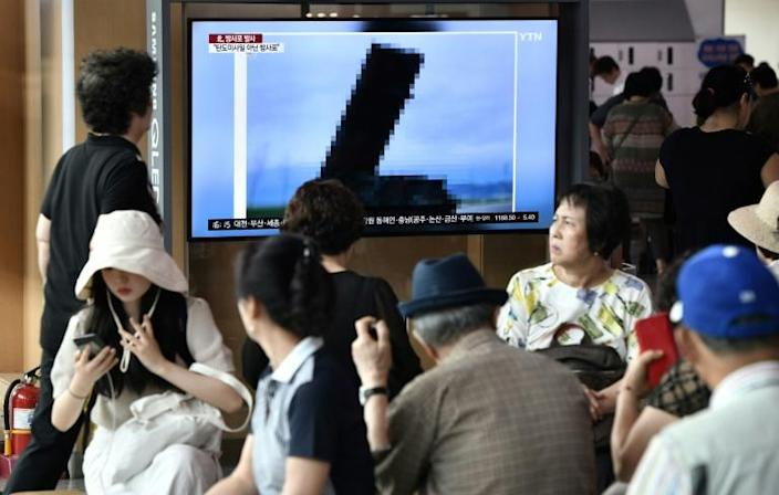 A television news screen shows a heavily pixellated image of North Korea's new rocket launcher (AFP Photo/Jung Yeon-je)
