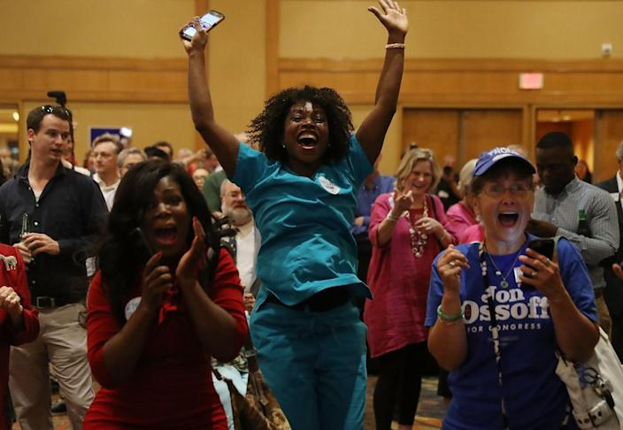 Erica Ferguson (C) and other supporters react as early return numbers show that Democratic candidate Jon Ossoff is in the early lead for Georgia's 6th Congressional District in a special election to replace Tom Price, who is now the secretary of Health and Human Services on April 18, 2017 in Atlanta, Georgia. (Photo: Joe Raedle/Getty Images)