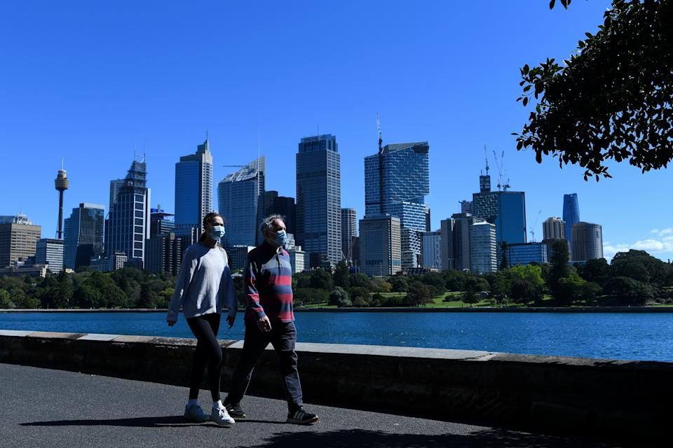 Members of the public exercise along Mrs Macquarie's Chair, in Sydney, Wednesday, September 22, 2021. Source: AAPq