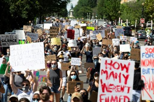 Hundreds of demonstrators walk down 16th Street NW during a rally north of Lafayette Square near the White House to protest police brutality and racism, on June 7, 2020