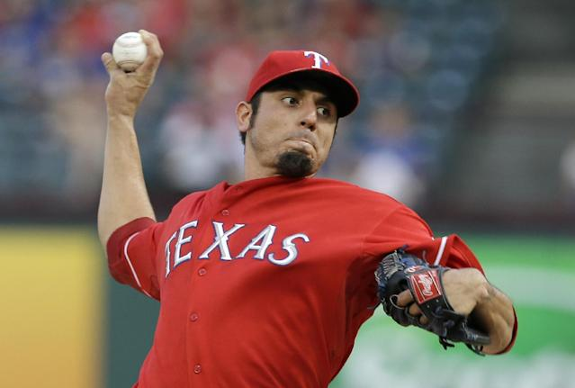 Texas Rangers starting pitcher Matt Garza (22) works against the Houston Astros in the first inning of a baseball game Monday, Aug. 19, 2013, in Arlington, Texas. (AP Photo/Tony Gutierrez)
