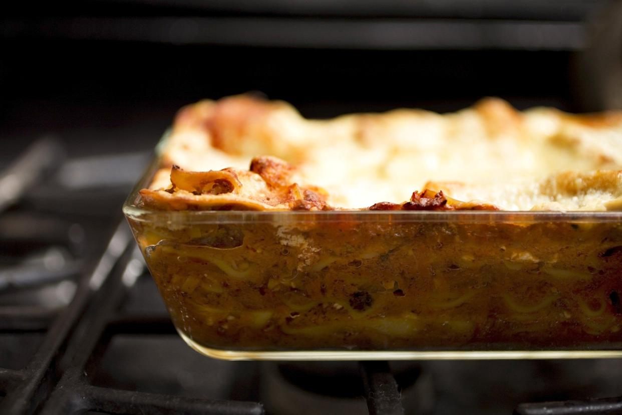 Lasagna in a glass baking dish in the oven