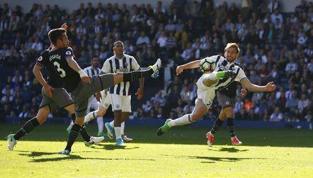 Britain Football Soccer - West Bromwich Albion v Southampton - Premier League - The Hawthorns - 8/4/17 West Bromwich Albion's Craig Dawson shoots at goal Action Images via Reuters / Peter Cziborra Livepic