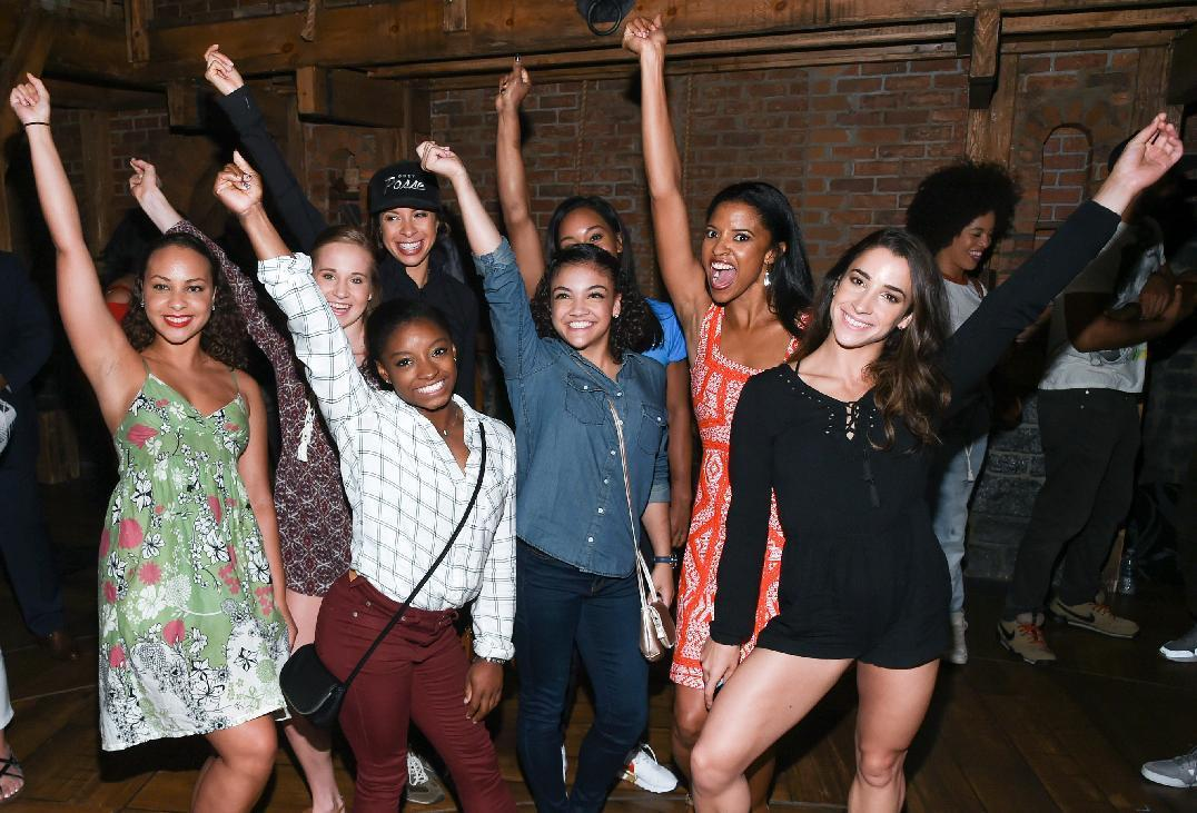 """Members of the """"Final Five"""" 2016 Rio Olympics gold medal winning U.S. Gymnastics team, Madison Kocian, Simone Biles, Gabby Douglas, Laurie Hernandez, and Aly Raisman pose with """"Hamilton"""" actors who play the Schuyler sisters, Jasmine Cephas Jones, Lexi Lawson and Renee Elise Goldsberry backstage after attending the performance at the Richard Rogers Theatre on Tuesday, Aug. 23, 2016, in New York. (Photo by Evan Agostini/Invision/AP)"""