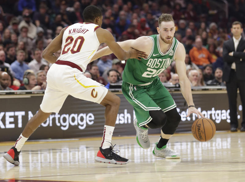 Boston Celtics' Gordon Hayward, right, drives past Cleveland Cavaliers' Brandon Knight in the first half of an NBA basketball game, Tuesday, Nov. 5, 2019, in Cleveland. (AP Photo/Tony Dejak)