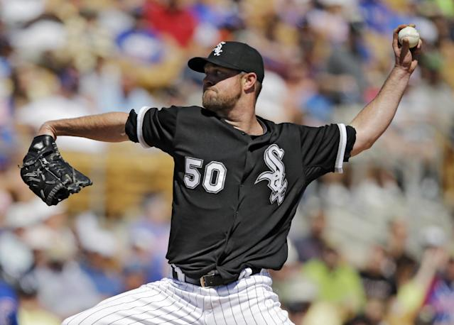 Chicago White Sox starting pitcher John Danks delivers against the Chicago Cubs in the fourth inning of a spring exhibition baseball game Friday, March 21, 2014, in Glendale, Ariz. (AP Photo/Mark Duncan)