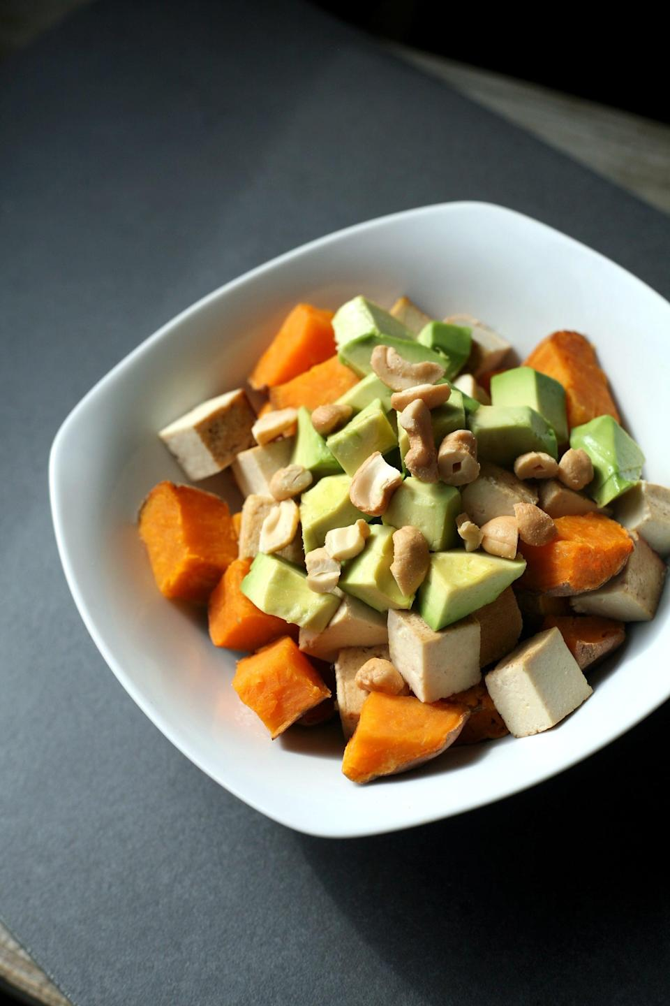 """<p>This bowl tastes perfect on its own, but adding a little crunchy texture with some chopped salted cashews makes it even more delicious.</p> <p><strong>Get the recipe:</strong> <a href=""""https://www.popsugar.com/fitness/Sweet-Potato-Tofu-Avocado-Breakfast-43269919"""" class=""""link rapid-noclick-resp"""" rel=""""nofollow noopener"""" target=""""_blank"""" data-ylk=""""slk:sweet potato, tofu, and avocado bowl"""">sweet potato, tofu, and avocado bowl</a></p>"""