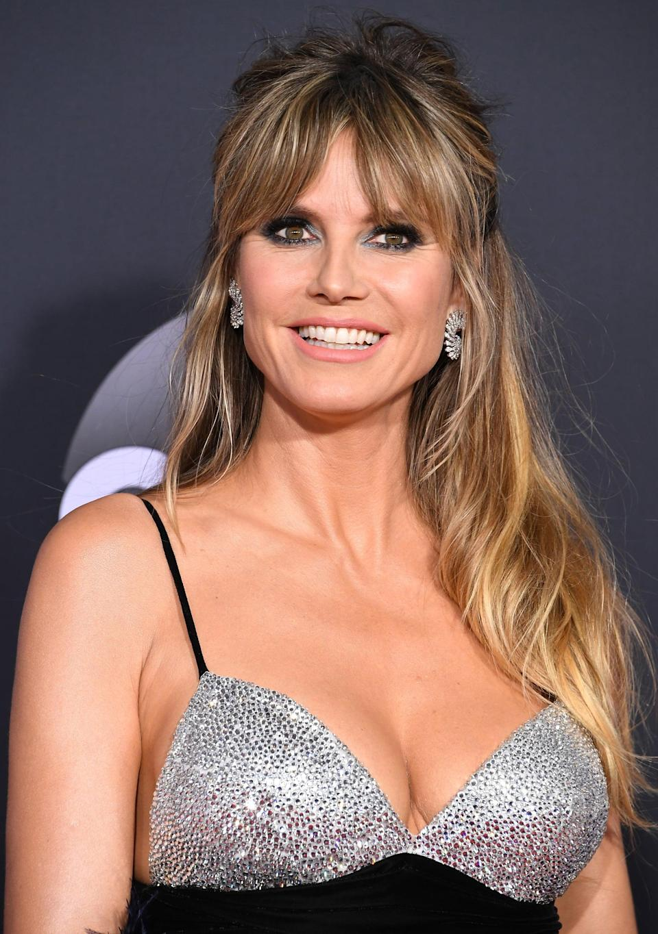 """<p>In 2008, the model had her then-husband Seal's name tattooed on her right forearm. The couple divorced in 2014, and <a href=""""https://people.com/celebrity/heidi-klum-removing-seal-tattoo/"""" class=""""link rapid-noclick-resp"""" rel=""""nofollow noopener"""" target=""""_blank"""" data-ylk=""""slk:Klum has since had the tattoo removed"""">Klum has since had the tattoo removed</a>.</p>"""