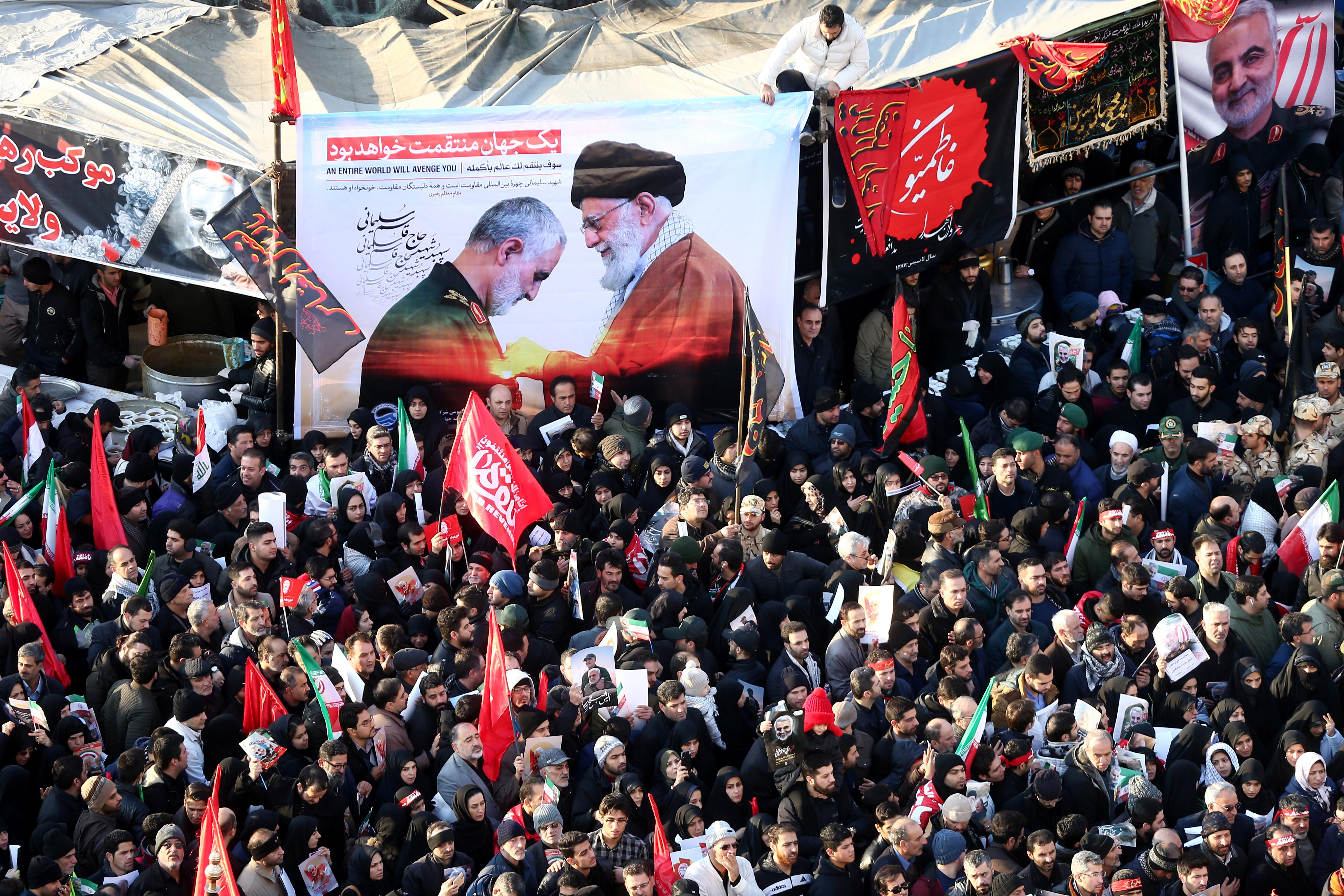 Iranian people attend a funeral procession for Iranian Major-General Qassem Soleimani, head of the elite Quds Force, and Iraqi militia commander Abu Mahdi al-Muhandis, who were killed in an air strike at Baghdad airport, in Tehran, Iran January 6, 2020. Nazanin Tabatabaee/WANA (West Asia News Agency) via REUTERS ATTENTION EDITORS - THIS IMAGE HAS BEEN SUPPLIED BY A THIRD PARTY