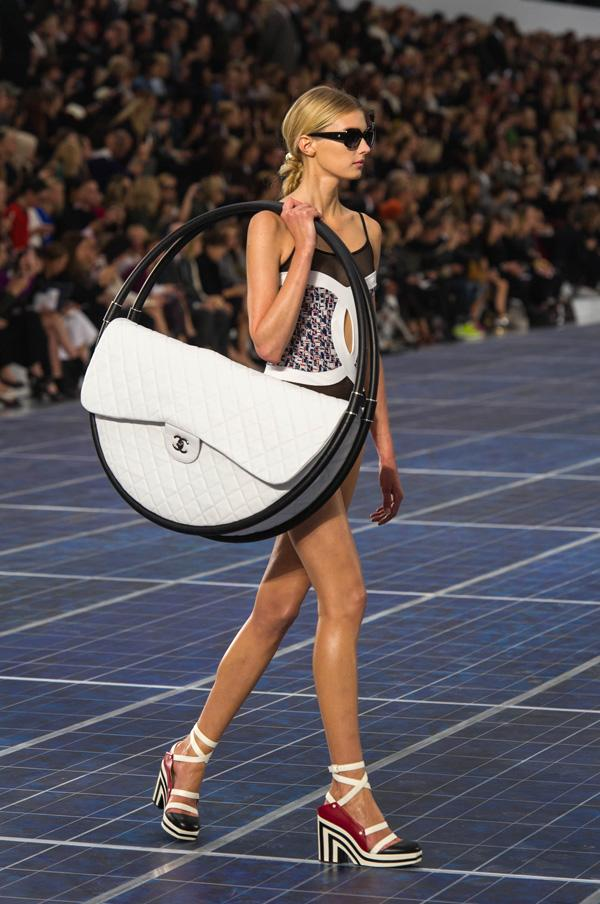 "Chanel Spring 2013 ""Hula Hoop"" bag, price to be determined Most Chanel bags make us drool, but this massive quilted purse sandwiched between two hula hoops is mind boggling. How would you fit it in a car? Do the hula hoops detach? Is Nicki Minaj already on the waiting list?"