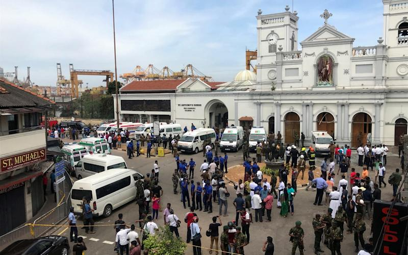 Sri Lankan military officials stand guard in front of the St. Anthony's Shrine, Kochchikade church after an explosion in Colombo - REUTERS