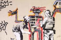 New murals by graffiti artist Banksy seen on September 18, 2017 on a wall near the Barbican Centre in London, UK.The work mark the opening of an exhibition by New York graffiti artist turned painter Jean-Michel Basquiat. (Photo by Claire Doherty/Sipa USA)