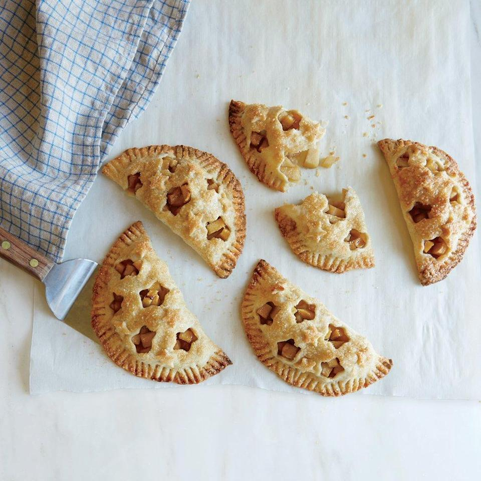 """<p>Use small cookie or pastry cutters to create little steam vents in the tops of these pies for the filling to peek through. You can make these pies as festive or as simple as you want, but however you style them, they're sure to be absolutely delicious.</p> <p><a href=""""https://www.myrecipes.com/recipe/apple-hand-pies-0"""" rel=""""nofollow noopener"""" target=""""_blank"""" data-ylk=""""slk:Apple Hand Pies Recipe"""" class=""""link rapid-noclick-resp"""">Apple Hand Pies Recipe</a></p>"""