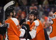 Philadelphia Flyers' Travis Konecny, right, celebrates with Scott Laughton after a victory in a shootout during an NHL hockey game against the Boston Bruins, Monday, Jan. 13, 2020, in Philadelphia. The Flyers won 6-5. (AP Photo/Derik Hamilton)