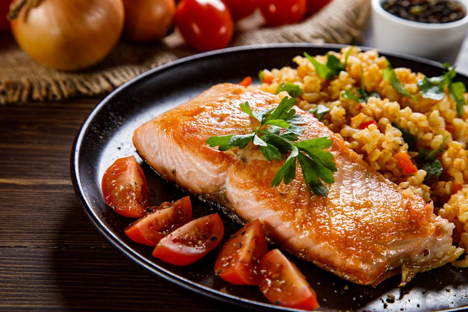 Grilled salmon with groats and vegetables