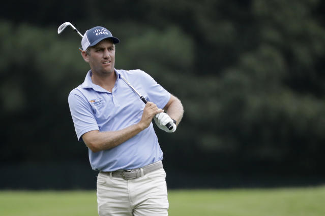 Brendon Todd watches his shot on the second hole during the second round of the World Golf Championship-FedEx St. Jude Invitational Friday, July 31, 2020, in Memphis, Tenn. (AP Photo/Mark Humphrey)