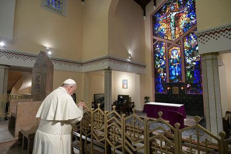 Pope Francis prays during a meeting with representatives of other Christian denominations at Saint Peter's Cathedral in Rabat, Morocco, March 31, 2019. Vatican Media/Handout via REUTERS
