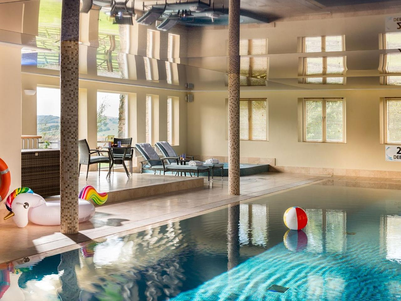 "<p>For a gorgeous cottage with a pool inside, this farmhouse has its own leisure centre so you can finally get <a href=""https://www.womenshealthmag.com/uk/fitness/workouts/a707720/gym-workout/"" target=""_blank"">the gym</a> all to yourself! The entire lower ground floor consists of the 15-metre heated swimming pool, a separate steam room and sauna, a built-in sunken 7-seater Jacuzzi and a spiral staircase that leads down to a small <a href=""https://www.womenshealthmag.com/uk/fitness/a30762241/kate-hudson-pilates-workout/"" target=""_blank"">yoga and Pilates</a> area. You'll want to click through the photos of the rest of the house too - seriously impressive!</p><p><strong>Sleeps:</strong> 18</p><p><strong>Pets: </strong>No</p><p><strong>Bring:</strong> All your workout gear to make the most of having a whole leisure centre to yourself. </p><p><strong>Price: </strong>3 nights from £3,442</p><p><strong>Available from: </strong><a href=""https://go.redirectingat.com?id=127X1599956&url=https%3A%2F%2Fwww.sykescottages.co.uk%2Fcottage%2FLake-District-Cumbria-The-Lake-District-Sedbergh%2FHigh-Fellside-Hall-947265.html&sref=https%3A%2F%2Fwww.womenshealthmag.com%2Fuk%2Ffitness%2Ffitness-holidays%2Fg33559308%2Fcottages-with-pools%2F"" target=""_blank"">Sykes Holiday Cottages</a></p>"