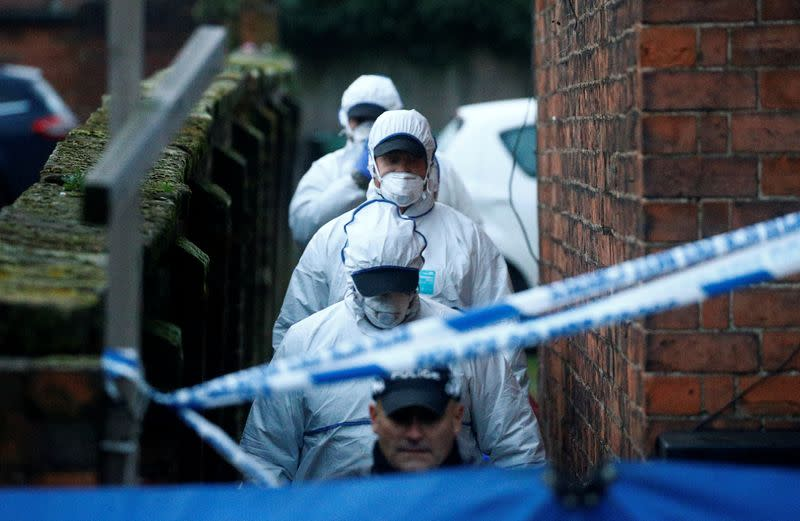 Forensic officers walk outside a property, which is being searched in connection with yesterday's stabbing on London Bridge, in which two people were killed, in Stafford