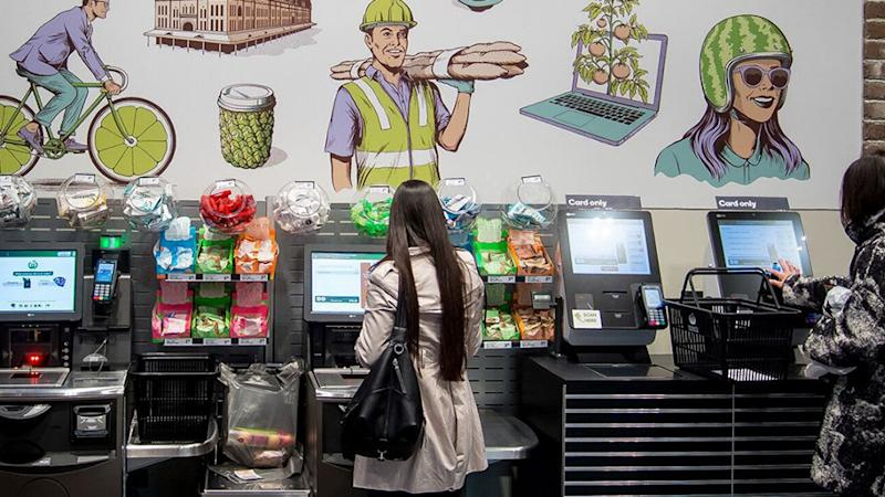 Picture of the self-serve check outs at a Woolworths