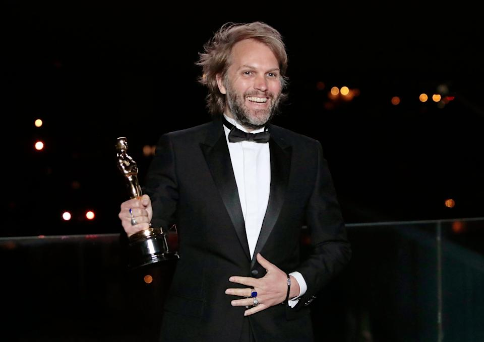 Florian Zeller with his Oscar after winning the Best Adapted Screenplay for the 'The Father'Getty