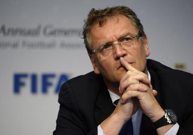 FIFA Secretary General Jerome Valcke listens during a press conference following the 128 Annual General Meeting of the International Football Association Board IFAB, on Saturday, March 1, 2014, in Zurich, Switzerland. (AP Photo/Keystone,Steffen Schmidt)