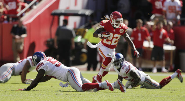 Kansas City Chiefs kick returner Dexter McCluster (22) runs through New York Giants defenders for a touchdown during the second half of an NFL football game at Arrowhead Stadium in Kansas City, Mo., Sunday, Sept. 29, 2013. (AP Photo/Charlie Riedel)