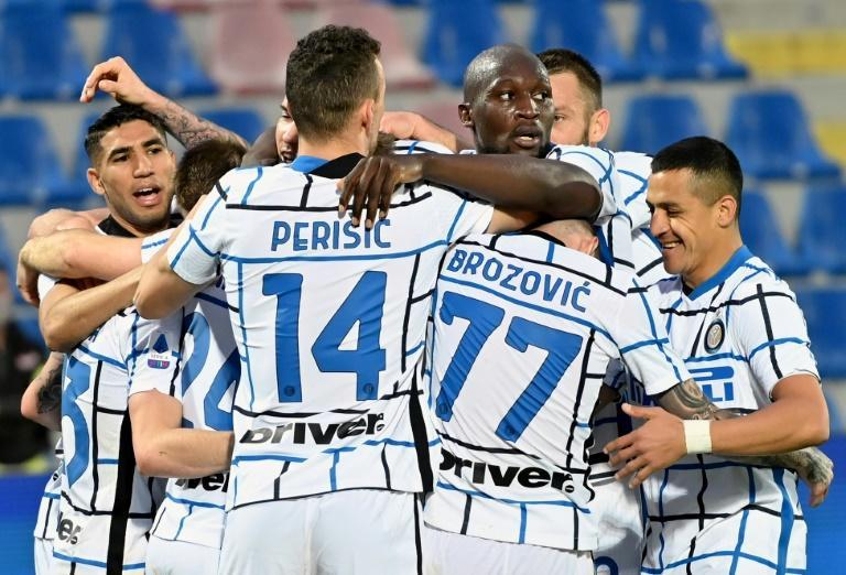Inter players celebrate after Christian Eriksen put them ahead against Crotone