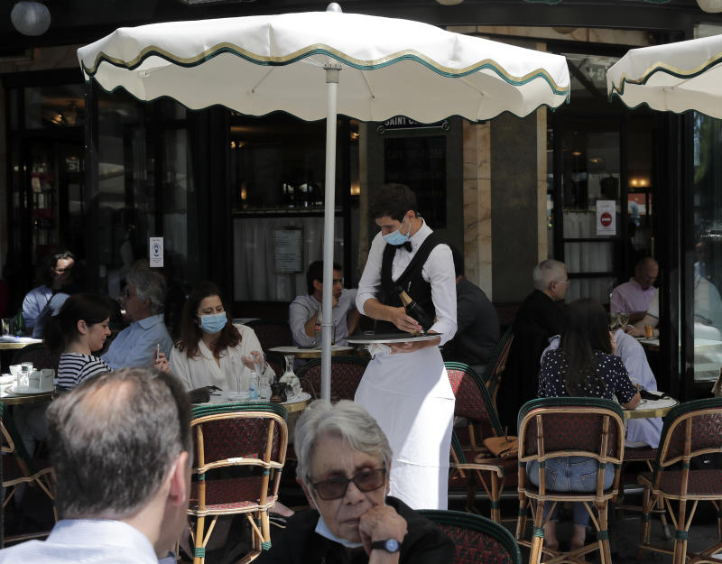 Virus Outbreak Paris Cafes Photo Gallery