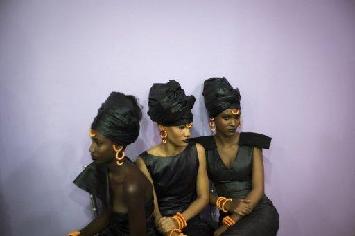 "Models wait backstage before a show at ""Black Fashion Week"""