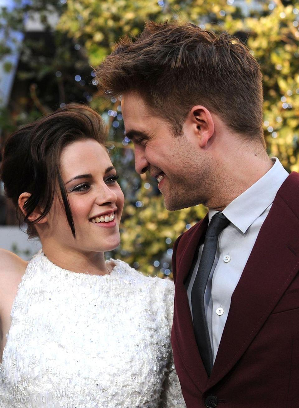 """<p>While playing Bella Swan and Edward Cullen in the movie adaptation of the Twilight saga, Kristen Stewart and Robert Pattison took their chemistry off screen in 2009. </p><p>Their relationship came to an abrupt end three years later when Kristen admitted to cheating on Robert with Snow White and The Huntsman director, Rupert Sanders. 'I'm deeply sorry for the hurt and embarrassment I've caused to those close to me and everyone this has affected,' <a href=""""https://people.com/celebrity/kristen-stewarts-apology-to-robert-pattinson-for-cheating/"""" rel=""""nofollow noopener"""" target=""""_blank"""" data-ylk=""""slk:Kristen said"""" class=""""link rapid-noclick-resp"""">Kristen said</a>. 'This momentary indiscretion has jeopardised the most important thing in my life, the person I love and respect the most, Rob. I love him, I love him, I'm so sorry.'</p>"""