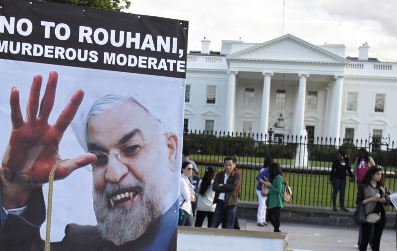 Iranian Americans protest against a conversation between U.S. President Barack Obama and new Iranian President Hassan Rouhani, outside the White House in Washington September 28, 2013. Obama and Rouhani spoke by telephone on Friday, the highest-level contact between the two countries in three decades and a sign that they are serious about reaching a pact on Tehran's nuclear program. REUTERS/Yuri Gripas (UNITED STATES   - Tags: POLITICS CIVIL UNREST)