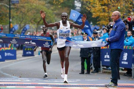 Geoffrey Kamworor of Kenya crosses the finish line to win the New York City Marathon in Central Park in New York, U.S., November 5, 2017. REUTERS/Brendan McDermid