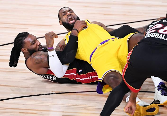 ORLANDO, FLORIDA SEPTEMBER 30, 2020-Lakers LeBron James and Heat's Jae Crowder get tangeled wile battling for a loose ball in the 2nd quarter in Game 1 of the NBA FInals in Orlando Wednesday. (Wally Skalij/Los Angeles Times)
