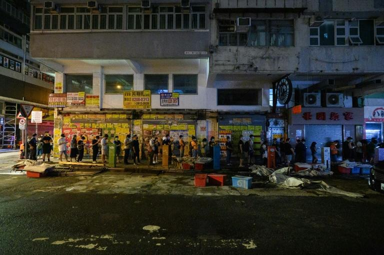 People queue for the last edition of the Apple Daily newspaper in Hong Kong