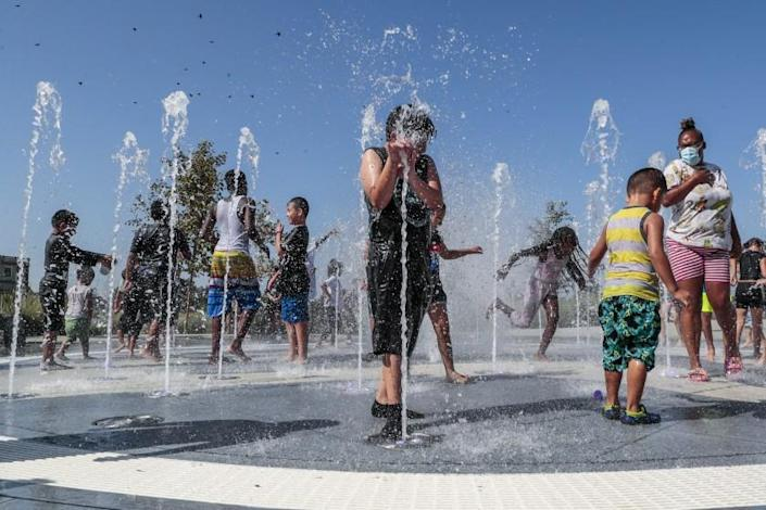 """Los Angeles, CA, Monday, Sept. 6, 2021 - Children frolic in a playground water fountain at Earvin """"Magic"""" Johnson Park. (Robert Gauthier/Los Angeles Times)"""