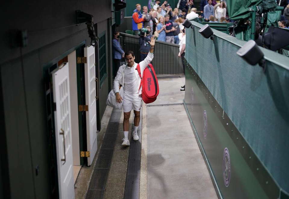 Switzerland's Roger Federer leaves Centre Court after defeating Italy's Lorenzo Sonego during the men's singles fourth round match on day seven of the Wimbledon Tennis Championships in London, Monday, July 5, 2021. (AP Photo/Alberto Pezzali)