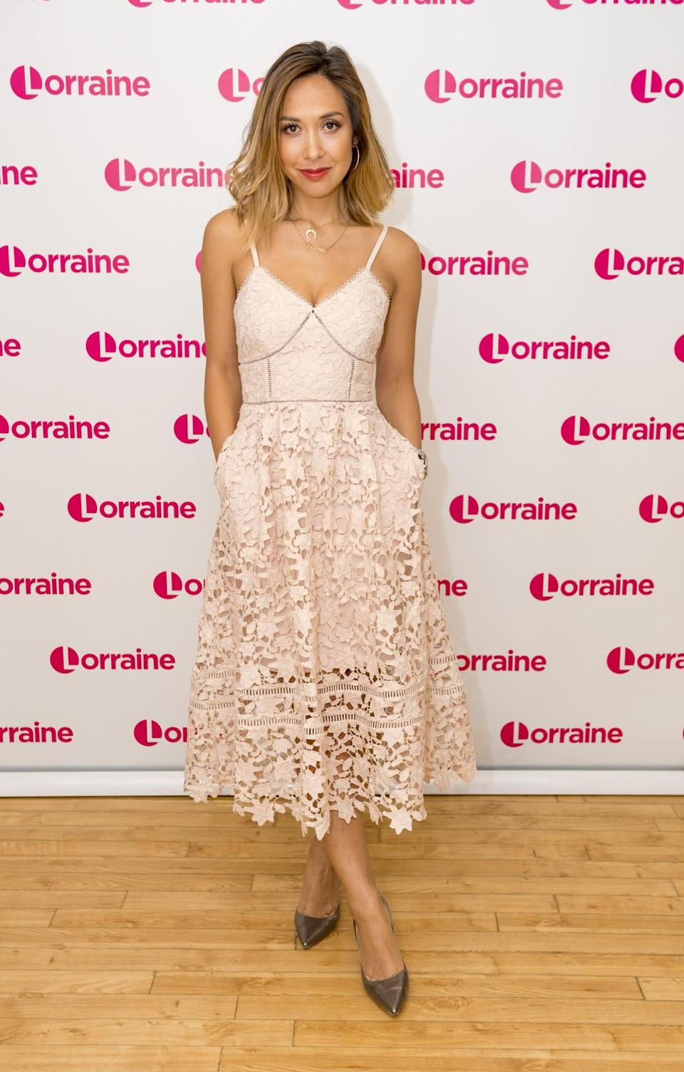 <p>Looking lovely in lace, Myleene rocked one dreamy summer frock on the popular chat show this week. <i>[Photo: Rex Features]</i></p>