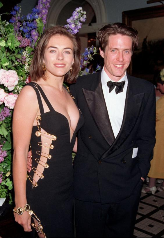 Actress Elizabeth Hurley wears a Giani Versace dress to the premiere of 'Four Weddings and A Funeral' held in Leicester Square on March 09, 1994 in London, England. (Getty Images)