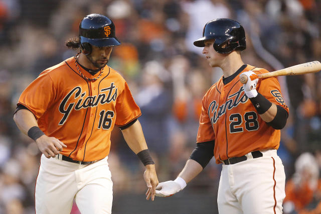 San Francisco Giants' Angel Pagan (16) is congratulated by Buster Posey (28) after scoring a run against the Minnesota Twins in the third inning of a baseball game Friday, May 23, 2014, in San Francisco. (AP Photo/Tony Avelar)
