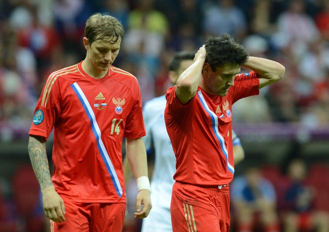 Russian forward Roman Pavlyuchenko and Russian midfielder Roman Shirokov (R) reacts after the Euro 2012 championships football match Greece vs Russia on June 16, 2012 at the National Stadium in Warsaw.    AFP PHOTO / CHRISTOF STACHECHRISTOF STACHE/AFP/GettyImages