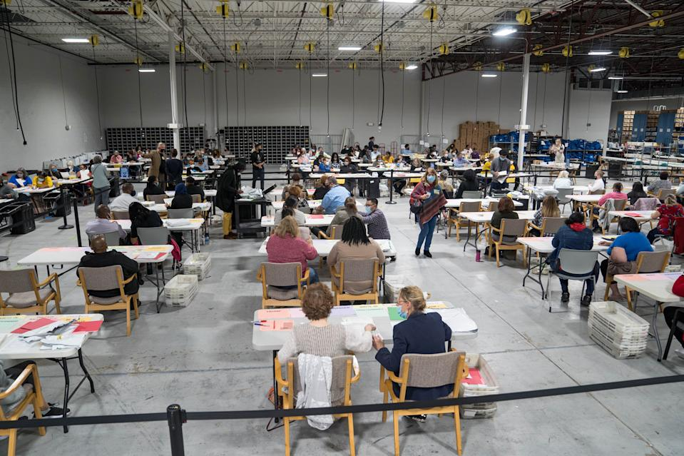 Gwinnett County election workers handle ballots as part of the recount for the 2020 presidential election at the Beauty P. Baldwin Voter Registrations and Elections Building on November 16, 2020 in Lawrenceville, Georgia. (Photo by Megan Varner/Getty Images)