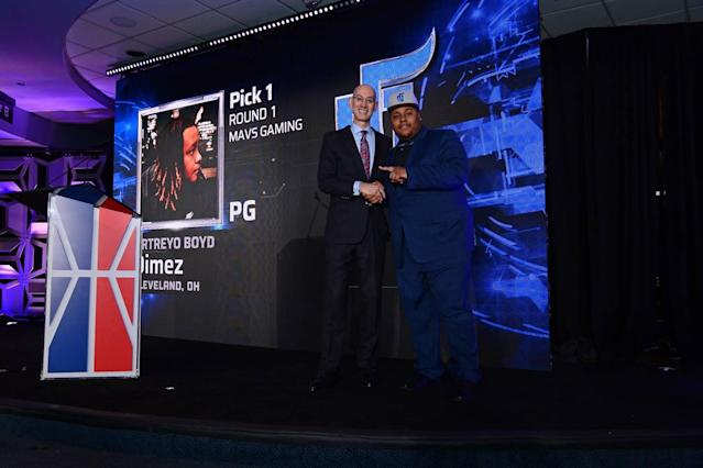 Artreyo Boyd, a.k.a. Dimez, poses with NBA commissioner Adam Silver after being drafted first in the 2K League. (NBA Photos)