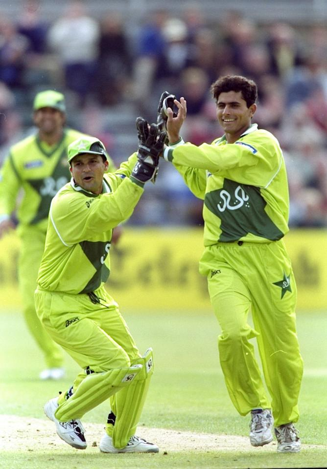 16 May 1999:  Moin Khan of Pakistan congratulates his team mate Abdul Razzaq after taking a West Indian wicket during the Cricket World Cup Group B match played in Bristol, England. Pakistan won the game by 27 runs. \ Mandatory Credit: Laurence Griffiths/Allsport
